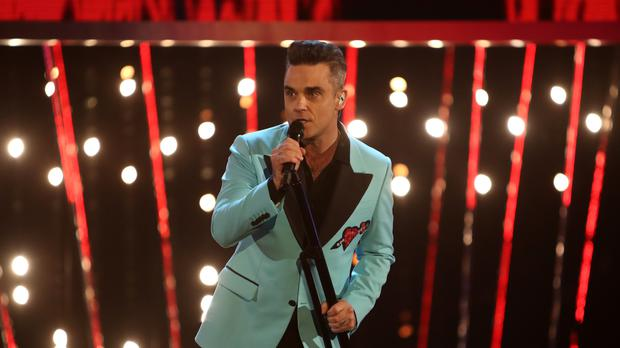 Robbie Williams performs during the 2016 BBC Sports Personality of the Year awards