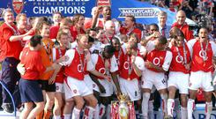 Arsenal players celebrate winning the Premier League title in 2004