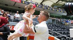 Australia's David Warner with his daughter