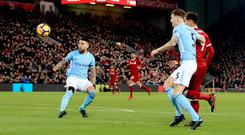 Liverpool's Roberto Firmino (right) scores against Manchester City in the Premier League