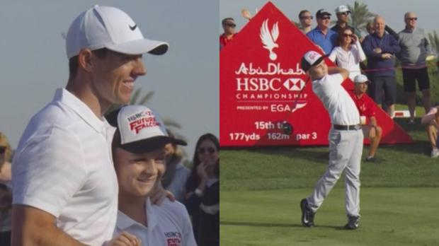 Rory McIlory embraces Oscar Murphy at the Abu Dhabi HSBC Championship