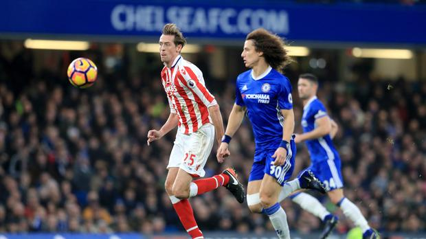 Stoke City's Peter Crouch (left) and Chelsea's David Luiz battle for the ball during a Premier League match (Adam Davy/PA)