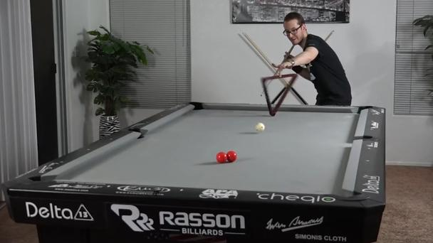 Venom manages to pot two reds through a spinning rack (Venom Trickshots/PA)