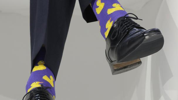 Canadian prime minister Justin Trudeau wearing yellow duck sock at the WEF in Davos (Markus Schreiber/AP)