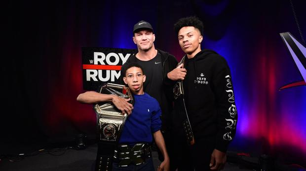Charles and Shanquis pose with Randy Orton