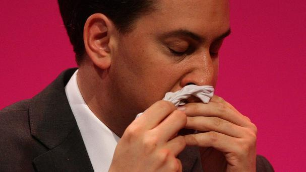Former Labour leader Ed Miliband wipes his nose