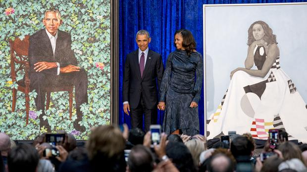 The portraits were revealed on Monday (Andrew Harnik/AP)