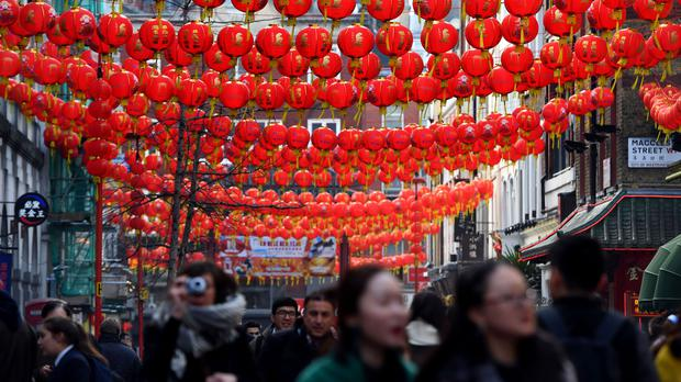 Lanterns are strung across Gerrard Street in Chinatown, London (Victoria Jones/PA)