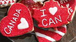 Olympic cookies supporting Canada and one supporting the US. (Meggsterr)