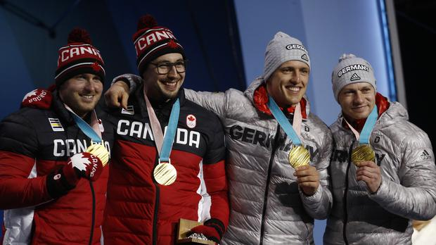Germany and Canada share the gold medal in the two-man bobsled event at the 2018 Winter Olympics in Pyeongchang