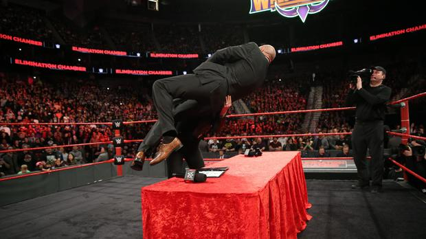 Ronda Rousey throws Triple H into a table