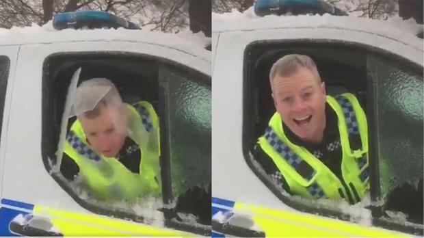 The policeman putting his head through ice