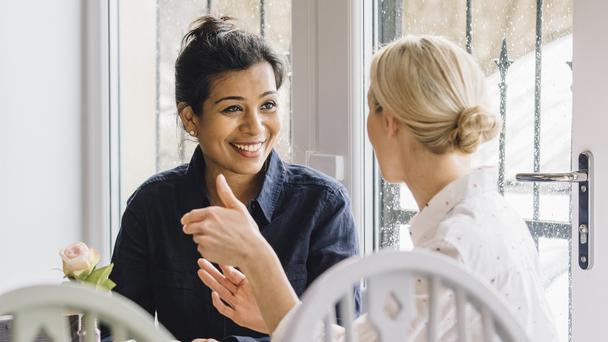 A stock image of women having a cup of tea together