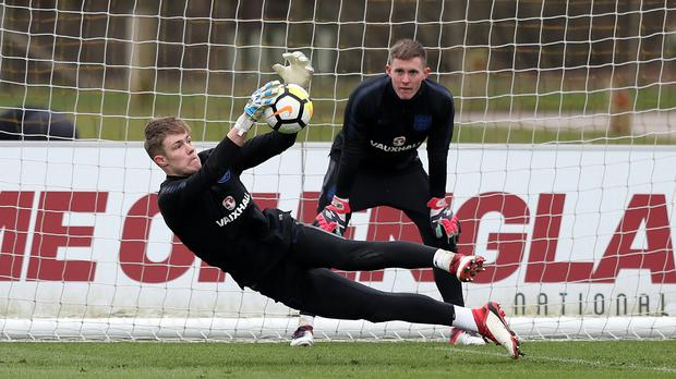 Two of England's under-21 goalkeepers during a training session