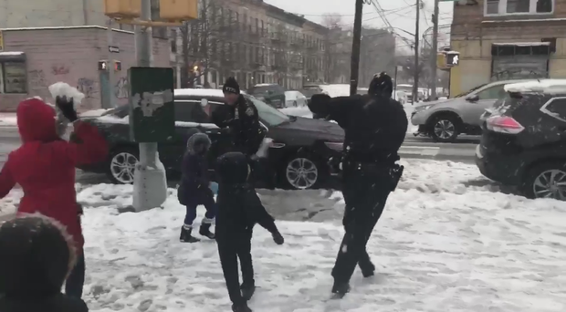 You need to see the world's cutest snowball fight between these police officers and little kids