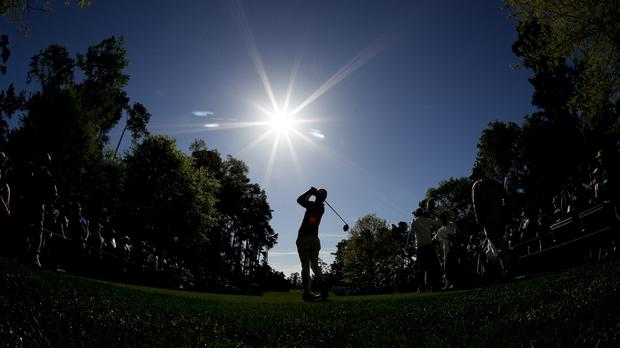 Wesley Bryan watches his tee shot during practice for the Masters golf tournament