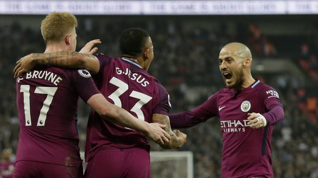 Manchester City footballers celebrate a goal against Tottenham Hotspur