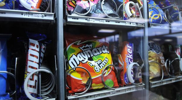 Vending machines selling unhealthy drinks and snacks should be banned from schools - report