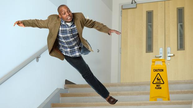 A man falling down some stairs