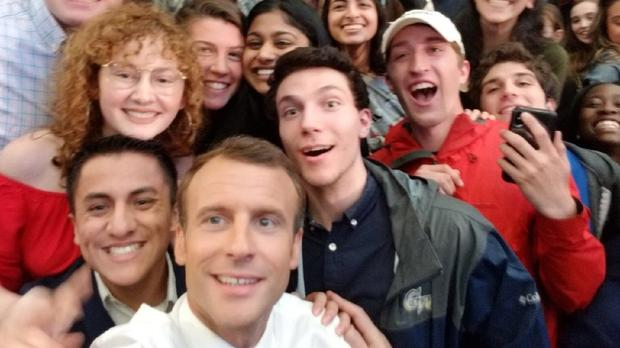 Emmanuel Macron taking a selfie