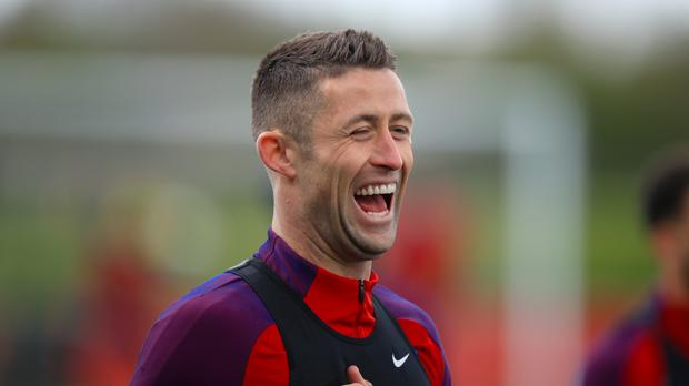England's Gary Cahill laughs during a training session