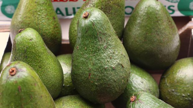 Avocados for sale on a stall in Berwick Street market, London