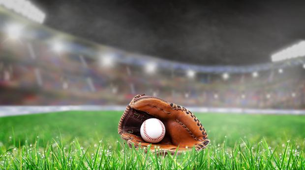 A baseball glove on the outfield