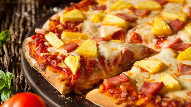 Pineapple on pizza, yes or no? (bhofack2/Getty Images)