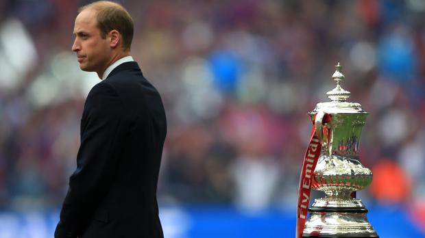 Prince William in front of the FA Cup trophy. (Nick Potts/PA)