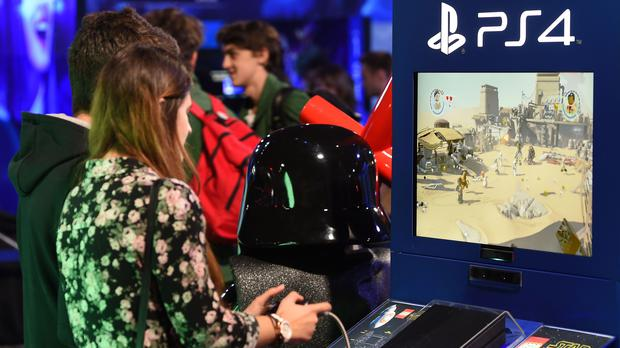 Gamers play LEGO Star Wars: The Force Awaken on the Playstation 4