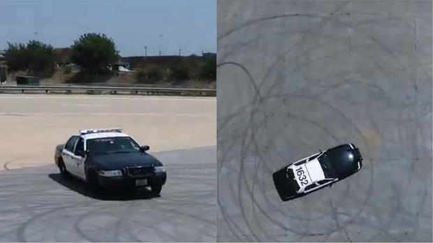 A police car creating circular tyre marks (Fort Worth Police Department/Twitter)