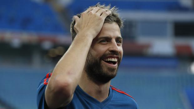 Spain defender Gerard Pique didn't feature today but may have enjoyed some tweets. (Manu Fernandez/AP)