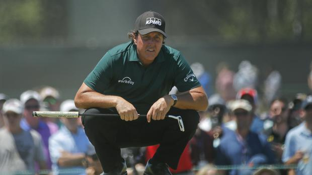 Phil Mickelson caused a storm when he deliberately hit his putt while it was still moving at US Open – (Carolyn Kaster/AP)