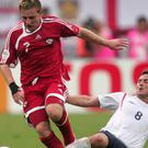 England's Frank Lampard tackles Trinidad and Tobago's Chris Birchall (Martin Rickett/PA)