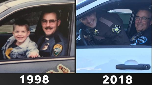 Police officer Andy Gould in 1998 with his son on his knee and replicating the picture in 2018 with his grown-up son, now a sheriff's deputy (Auburn WA Police Department/PA)