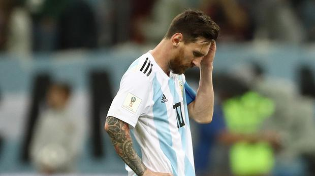 Argentina's Lionel Messi looks dejected after his side concede a second goal -(Tim Goode/EMPICS Sport)