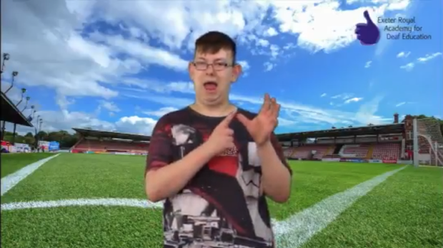 Kenny using sign language (Exeter City and Exeter Deaf Academy/Twitter)