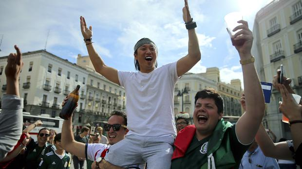World Cup fans celebrate (Andrea Comas/AP)