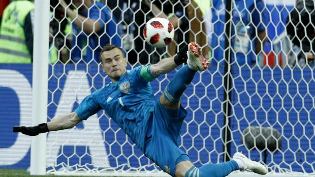 Russia goalkeeper Igor Akinfeev saves a penalty against Spain at the 2018 World Cup (Victor R. Caivano/AP)