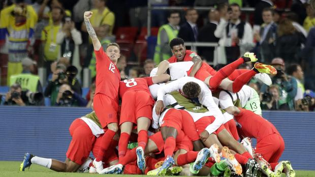 England players celebrate winning the penalty shoot-out in their last-16 game against Colombia at the 2018 World Cup – (Matthias Schrader/AP)