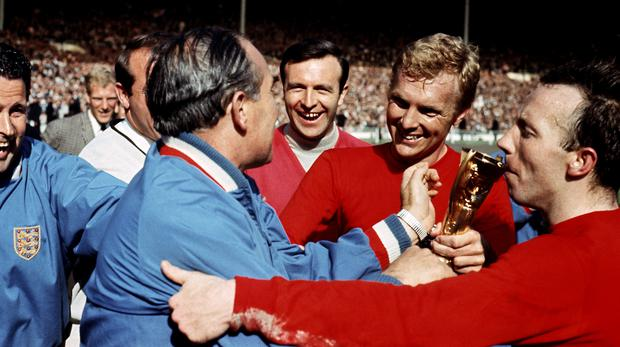 England celebrate winning the 1966 World Cup at Wembley Stadium – (Ron Bell/PA)