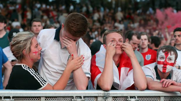 Devastated England fans after the match (Martin Rickett/PA)