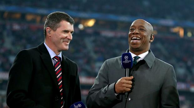 Roy Keane and Ian Wright share a laugh before a football match – (Mike Egerton/EMPICS Sport)
