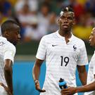 A photo of France footballers Blaise Matuidi, Paul Pogba and former France footballer Patrice Evra – (Joe Giddens/EMPICS Sport)