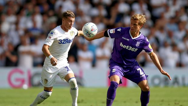 Leeds United and Stoke City footballers during a Championship game – (Nigel French/PA)