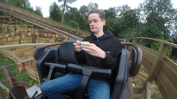 Thrillseeker Jacob Chambers solves a Rubik's cube (Alton Towers)