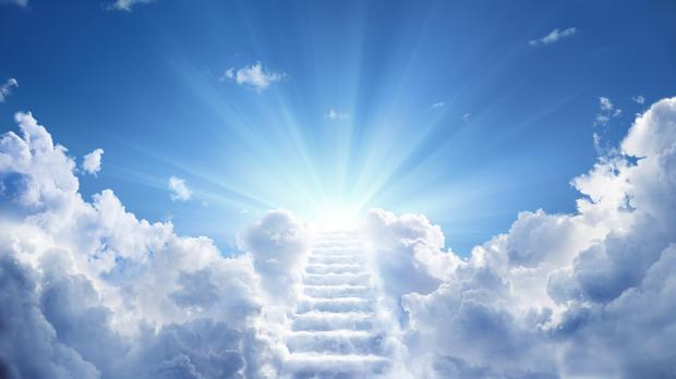 Stairs leading up to a heavenly light – (RomoloTavani/Getty Images)
