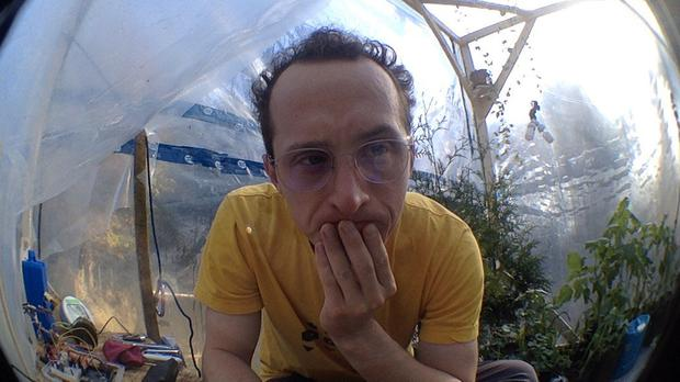 Kurtis Baute will be living inside the mini-greenhouse of his own construction with roughly 200 plants to clean his air and provide oxygen (Kurtis Baute/PA)