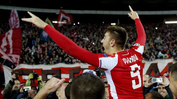Red Star Belgrade footballer Milan Pavkov celebrates winning a Champions League game against Liverpool – (Marko Drobnjakovic/AP)