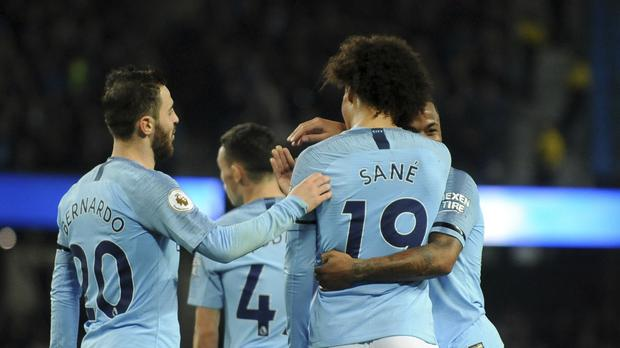 Manchester City's Leroy Sane, front, celebrates with teammates after scoring his side's sixth goal during a Premier League game – (Rui Vieira/AP)